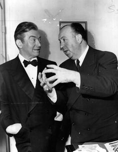Claude Rains and Alfred Hitchcock on the set of Notorious, 1946.
