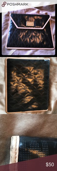 Marked Down⚡️Michael Kors Tablet case Black vinyl signature tablet case with gold inside and ran trim on outside . It fit my iPad 1st generation so will definitely work for anything smaller. Small black scuff on back top left corner. Was $50 marked to $40, now $20 Great deal ! Any questions please ask ! Thank you for visiting ! Michael Kors Accessories Tablet Cases