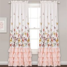 Adorn a window with the flowing ruffles and whimsical butterfly pattern on this curtain panel pair. Machine-washable polyester makes the curtains easy to maintain and durable with a rod-pocket header