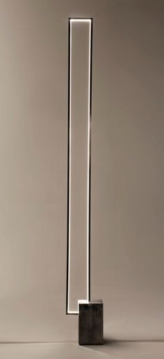The Mire : a floor lamp with a clear LED light strip inside a rectangular metal frame.