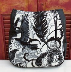 Black and White Goth, Antique, Skull and Spider Purse Over the Shoulder Purse  This bag is made for those days when you need more than your cell phone and wallet. There is plenty of room inside this purse to carry all the other things we think we need to carry around with us! This purse is made to wear over the shoulder.