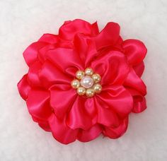 Satin flower tutorial - 1 yard of satin ribbon, scissors, lighter, needle and thread. Embellish, and finished!