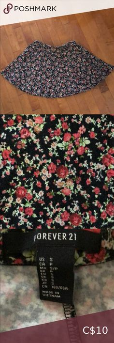 Floral mini skater skirt Black and coral floral print skirt. Size small. Runs smaller. Forever 21. Good condition. Forever 21 Skirts Mini Floral Print Skirt, Floral Prints, Mini Skater Skirt, Printed Skirts, Runes, Printer, Forever 21, Coral, Closet