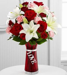 A beautiful combination of Roses and Asiatic Liilies to represent all the love and passion in your heart. Rich red roses, white Asiatic Lilies, pink mini carnations, burgundy mini carnations and lush greens.