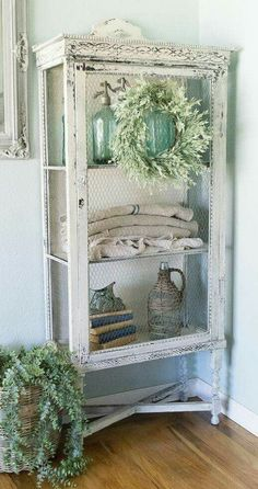 Breakout glass or wood panels add chicken wire.. voila airing cabinet! #shabbychichomesfarmhousestyle