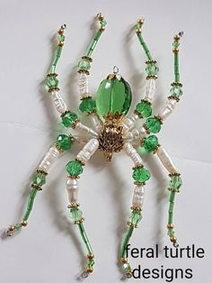 Items similar to Beaded Spider Suncatcher on Etsy Beaded Crafts, Beaded Ornaments, Wire Crafts, Wolf Spider, Spider Art, Diy Earrings And Necklaces, Christmas Spider, Spider Crafts, Beaded Spiders