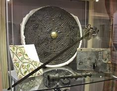 This targe (shield) is one of a pair found in the Dunollie dairy disguised as butter-churn lids. Weapons such as these were outlawed after 1745. The targe is made of oak and leather. It is brass-studded with green cloth on the back. It was made around 1715.