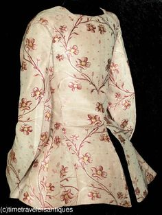 Side/back view of Figured Silk Brocade Caraco Jacket, England, c.1785, silk, linen lining to bodice, unlined sleeves with split cuffs.