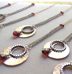 Hammered Disc Necklace with Garnet gemstone by LauraJDesigns00