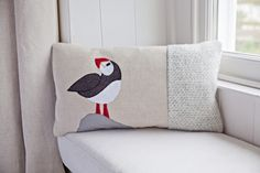 A personal favorite from my Etsy shop https://www.etsy.com/listing/230326293/handmade-puffin-cushion-with-mixed
