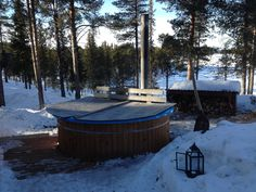 The hot tub warming up the water for us.  The 3 of us had some good fun sledging down the hill on to the lake.