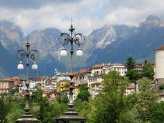 Perched on high bluffs above the Piave River and backed by the snowcapped Dolomites, Belluno is without…