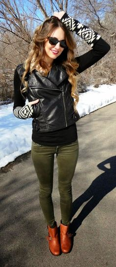 Fall/ winter outfit ideas. Olive green pants. Cognac ankle boots. Black Leather Moto Vest with Arm warmers