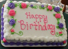 Floral+Birthday+cake+-+This+is+a+quarter+sheet+cake+done+in+buttercream+frosting.+I+love+the+roses+on+it.