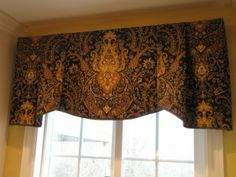 This simple to make board mounted valance uses one yard of fabric and a simple lip cord.  Great DIY project for under $50