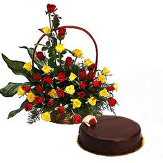 A basket arrangement of 30 yellow and red roses in a handle basket along with 500gm chocolate cake delivered ar midnight.