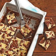 Try this incredible and easy brownie recipe that is fit to feed a crowd. A gentle swirl of a knife transforms brownie and cheesecake batters into an indulgent marbled bar that your crowd will go wild over.