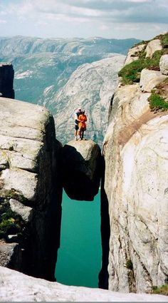 This place in Norway is called Kjerag, located near Stavanger on the south west coast. On the rock you are 1000 meters above the fjord.