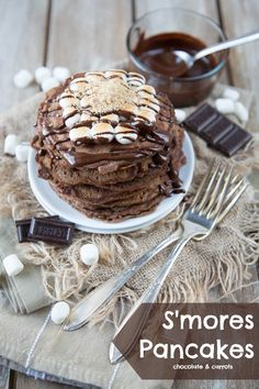 S'mores Pancakes made with whole wheat flour and low fat graham crackers | chocolateandcarrots.com #chocolate #breakfast #recipe