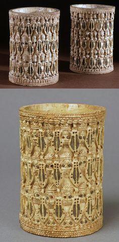 Nigeria | Carved armlets; elephant ivory inlaid with bronze.  Depicts 'eben' swords and the heads of Portuguese in large hats, between braided edging. | Benin City, Edo State | ca. 18th - 19th century