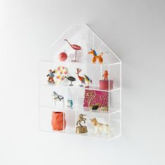 sprung on their spring-can i be a kid again?!! Invisible House Wall Shelf | The Land of Nod