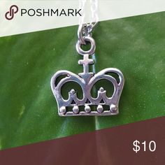 Crown Necklace Beautiful crown Necklace. Chain is silver plated finished with a lobster claw clasp. Measurements of the crown are 1/2 inch tall by 5/8 inch wide. Chain length is 18 inches. Jewelry Necklaces