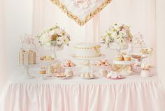 A pink and gold dessert buffet adds an idyllic touch to your reception or after-party. This pastel sweet table is enhanced by various gilded accents, including golden sugar roses and satin-faced bows.