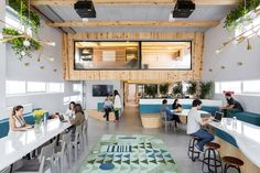 organized around a shared kitchen, the new workspace is a reflection of both the culture of the office and the country it is in.
