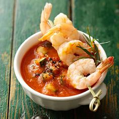 Roasted Tomato Gazpacho with Shrimp - Planning a patio dinner? Serve this delectable cold soup that makes a perfect summer appetizer using the season's best produce and herbs.