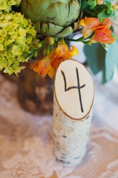 This is a creative way of using wood as table number. Pair it with lace and floral arrangement to achieve a perfect rustic wedding look decoration - Wooden Wedding Table Number Ideas