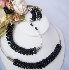 Black & Silver Wired Coiled Rope Choker Necklace Set by Tracy Parris  - This Set is made from Black Artistic Color Wire, and 12 gauge Silver Plated Round Wire, Coiled beautifully and comes as a complete set, with matching Earrings, Ring, and Bracelet.   The #Necklace and #Bracelet is adustable and can be fitted to any neck or wrist size.   Price: $75.00  On Artful Vision, http://www.artfulvision.com a portion of your purchase is donated to a participating non-profit of your choice. #fashion