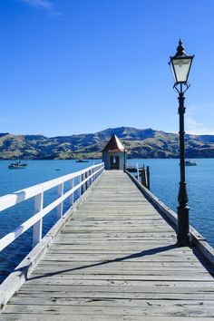 Long wooden pier in Akaroa, Banks Peninsula, Canterbury, South Island, New Zealand, Pacific by robertharding on 500px