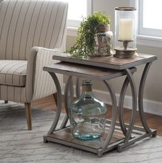 These reclaimed wood nesting end tables will easily add industrial glam style to your living space. Both tables are topped with authentic reclaimed fir and pine wood. Texture and color variations in this reclaimed wood vary, which means no two pieces are exactly same. Hourglass frames of tubular steel come in hand-finished antique pewter. FREE Economy Shipping - Includes 2 nesting tables - Genuine reclaimed pine and fir wood top - Reclaimed wood construction has variations which is normal…