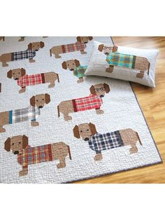 """Dogs in Sweaters includes instructions for making two quilt sizes and a 16"""" x 26"""" quilted pillow cover. These adorable dogs and their stylish sweaters are made using conventional patchwork techniques. The pattern also includes a complete li..."""