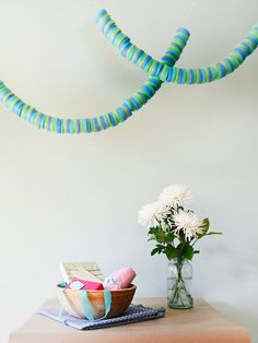 pool noodle garland. Cheap and easy DIY decor for parties. Would be cute in a boutique store window