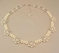 Items similar to Regal Elegance Woven Bridal Statement Necklace - Ivory Pearls and Clear Swarovski Austrian Crystal with silver accent beading on Etsy New Necklace Designs, Diy Jewelry Necklace, Pearl Pendant Necklace, Teardrop Necklace, Bridal Necklace, Pearl Jewelry, Crystal Jewelry, Wedding Jewelry, Beaded Jewelry
