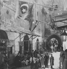 [Ottoman Empire] A Bazaar in Jerusalem, Palestine, Children and People in Street Market Place with the Ottoman Flags