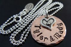 D2E Jewelry upcycled reclaimed penny jewelry  Hammered hand stamped penny charm necklace with wax cast sterling silver heart charm. $39.99, via Etsy.