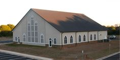 Steel church with brown standing seam roof