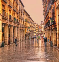 Calle Toledo in a rainy winter day. Madrid.