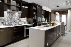 Candice Olson Kitchen (Dark cabs/ white countertops/steel hardware)