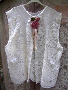 Victorian magnolia antique fairy lace vest in a pearl lace and a rose brooch. $43.00, via Etsy.