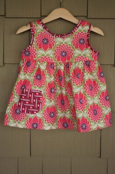 Super cute girls top (or dress if you make it longer).....tutorial covers pattern making through completion. Very good!