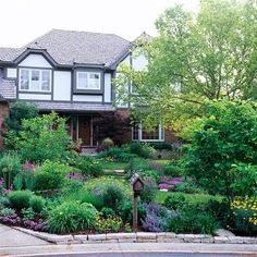 Mirror your home's color palate in your landscape to add visual appeal. More home-inspired landscaping ideas: http://www.bhg.com/gardening/landscaping-projects/landscape-basics/get-landscaping-ideas-from-your-house/