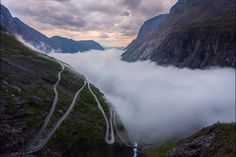 DANCING ON TROLLSTIGEN. A timelapse of the fog dancing back and forth across the valley below the famous Trollstigen road in Norway. This was taken over a twenty minute period at approximately 10:30pm as the sun was setting behind the mountains.