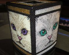 If you're a cat person, you will love this tissue topper. Each side has a pretty cat face in different colors with different colored eyes. Fits a standard sized boutique tissue box. Stitched on plastic canvas. Plastic Canvas Box Patterns, Plastic Canvas Coasters, Plastic Canvas Ornaments, Plastic Canvas Tissue Boxes, Plastic Canvas Christmas, Plastic Canvas Crafts, Crochet Cat Pattern, Crochet Dolls Free Patterns, Ppr
