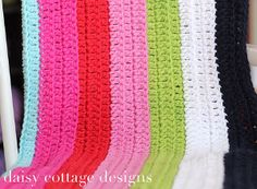 This crochet baby blanket is so easy and colorful, we decided to call it the Magical Baby Blanket. Using simple stitches and repeating rows, this striped crochet baby blanket will soon become your go-to pattern when you need an easy blanket to crochet. Finished with a cute scalloped edging, this baby blanket is as magical as can be.