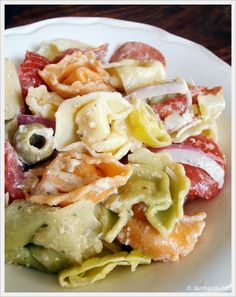 Tortellini Pasta Salad:   I used Newman's Own Caesar Dressing, both black and green olives, and cut up hard salami slices.