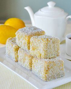Moist vanilla cake cubes dipped in lemon and coconut. Enjoy th… Lemon Lamingtons. Moist vanilla cake cubes dipped in lemon and coconut. Just enjoy them or dress them with raspberry compote and vanilla cream. Gourmet Recipes, Baking Recipes, Cake Recipes, Dessert Recipes, Lemon Recipes, Mini Cakes, Cupcake Cakes, Cupcakes, Lamingtons Recipe