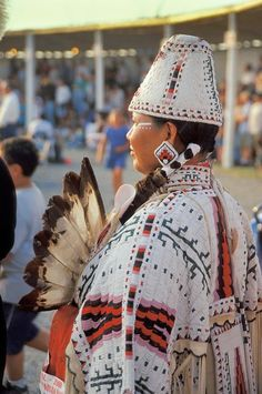 Woman dressed in fully beaded cylinder hat and cape during the Blackfeet NA Days Festival, Browning Montana